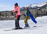 Mariela and a ski instructor race down Snowmass Mountain during the 2019 National Disabled Veterans Winter Sports Clinic.