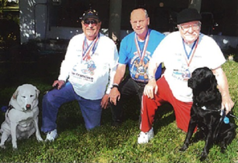 "From Left: Guide dog ""Thorn"" with Veteran Ray Trevino, Veteran Don Pecsenye, and Veteran Don Smith with his guide dog,"