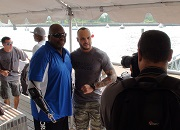 Chris Melendez, disabled Army Veteran, TNA Wrestling star and grand marshal of the 4th Annual Heroes on the Hudson event, at Pier 66 in Manhattan, greets a disabled Veteran.